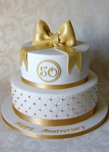 Двох'ярусний торт на золоте весілля